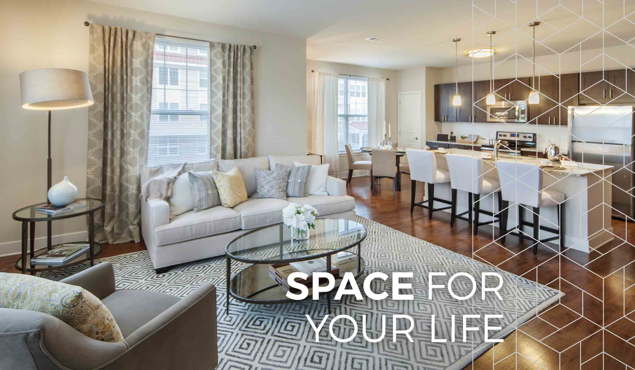 photo of living room and kitchen at Parc Plymouth Meeting apartments with white text overlay that reads, Space For Your Life